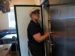 Angie searching in the refrigerator for that missing ingredient.